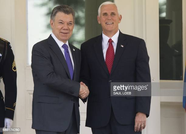 Vice President Mike Pence shakes hands with Colombian President Juan Manuel Santos prior to a breakfast meeting at the US Naval Observatory, the home...
