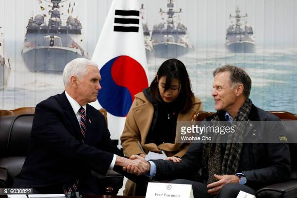 US Vice President Mike Pence shakes hands with Fred Warmbier the father of Otto warmbier who was imprisoned in North Korea for 17 months at the...