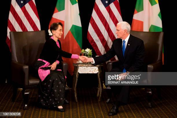 Vice President Mike Pence shakes hands with Myanmar State Counsellor Aung San Suu Kyi during a bilateral meeting on the sidelines of the 33rd...