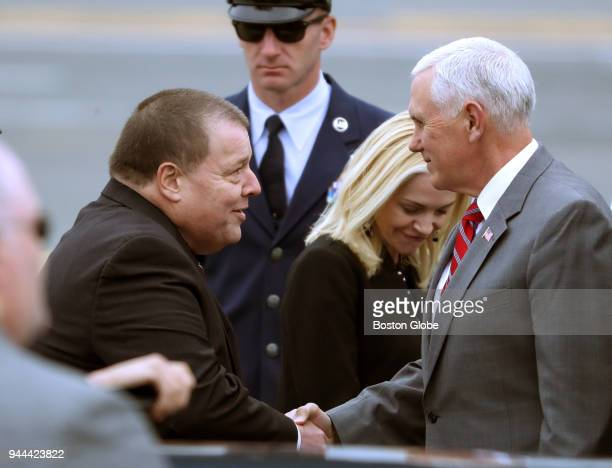 Vice President Mike Pence shakes hands with Quincy Mayor Thomas Koch upon his arrival at Boston Logan International Airport to attend a fundraising...