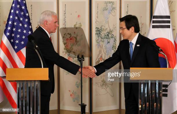 US Vice President Mike Pence shakes hands with South Korean acting president and prime minister Hwang Kyoahn during their joint press conference on...
