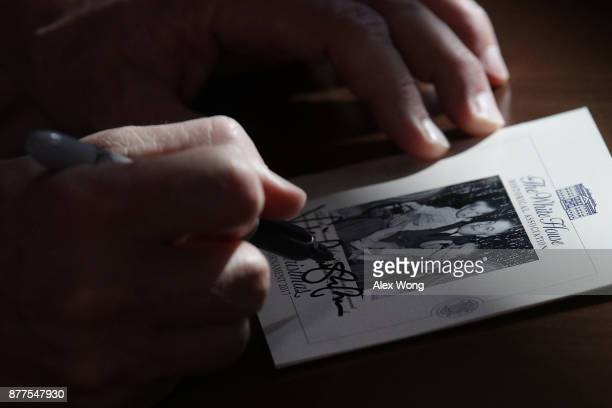 S Vice President Mike Pence signs a card for Marine Corps veteran Liam Dwyer at the USO Warrior and Family Center November 22 2017 in Bethesda...