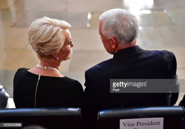 S Vice President Mike Pence sits with Cindy McCain as the casket of former Senator John McCain in the Capitol Rotunda lies in state at the US Capitol...