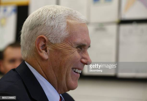 US Vice President Mike Pence smiles during an event at the American Axle Manufacturing Inc facility in Auburn Hills Michigan US on Thursday Sept 28...