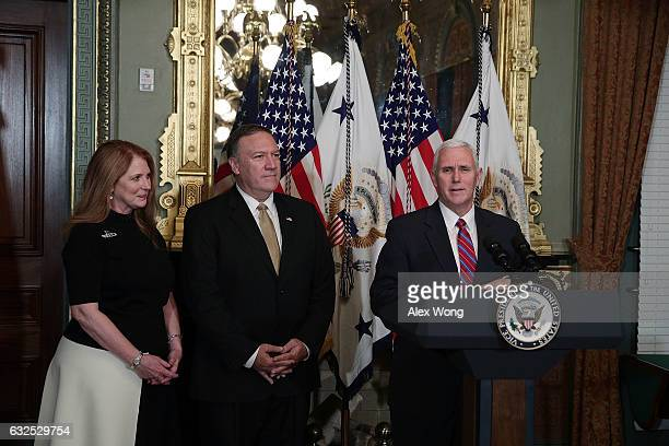 S Vice President Mike Pence speaks as Mike Pompeo and wife Susan Pompeo look on during a swearing in ceremony for Pompeo to become CIA Director at...