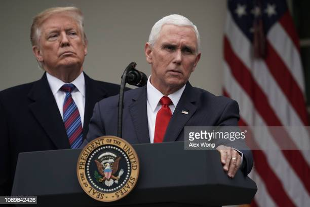 S Vice President Mike Pence speaks as President Donald Trump listens in the Rose Garden of the White House on January 4 2019 in Washington DC Trump...