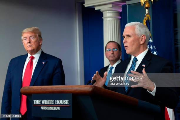 Vice President Mike Pence speaks as US President Donald Trump looks on during the daily briefing on the novel coronavirus, COVID-19, in the Brady...