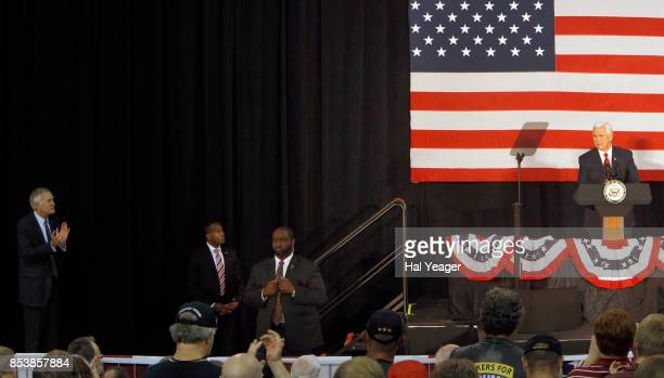 Vice President Mike Pence speaks at a campaign rally as Sen Luther Strange applauds at HealthSouth Aviation on September 25 2017 in Birmingham...