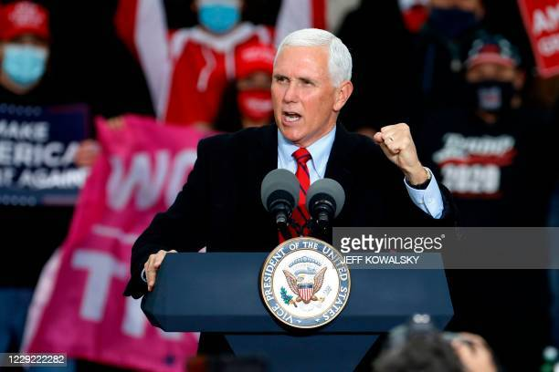 """Vice President Mike Pence speaks during a """"Make America Great Again!"""" campaign event at Oakland County International Airport in Waterford, Michigan,..."""