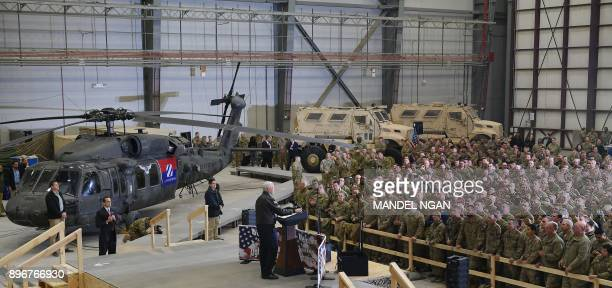 US Vice President Mike Pence speaks to troops in a hangar at Bagram Air Field in Afghanistan on December 21 2017 POOL / AFP PHOTO / POOL / MANDEL NGAN
