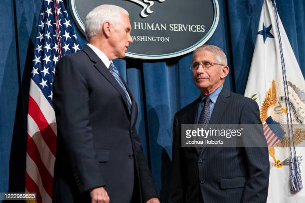 Vice President Mike Pence speaks with Director of the National Institute of Allergy and Infectious Diseases Anthony Fauci after leading a White House...