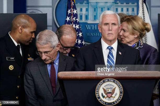 S Vice President Mike Pence standing with members of the White House Coronavirus Task Force team speaks during a press briefing in the press briefing...