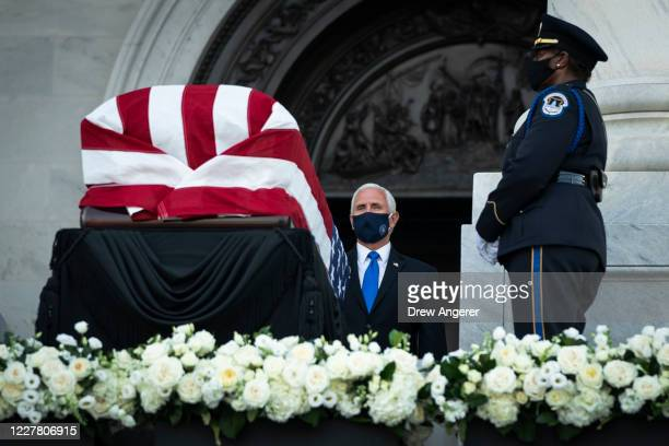S Vice President Mike Pence stands at the flagdraped casket bearing the remains of Rep John Lewis at the top of the East Front Steps of the US...