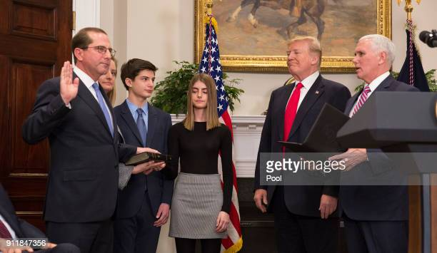 Vice President Mike Pence swears in Alex Azar as the new Secretary of the Department of Health and Human Services as President Donald J Trump looks...