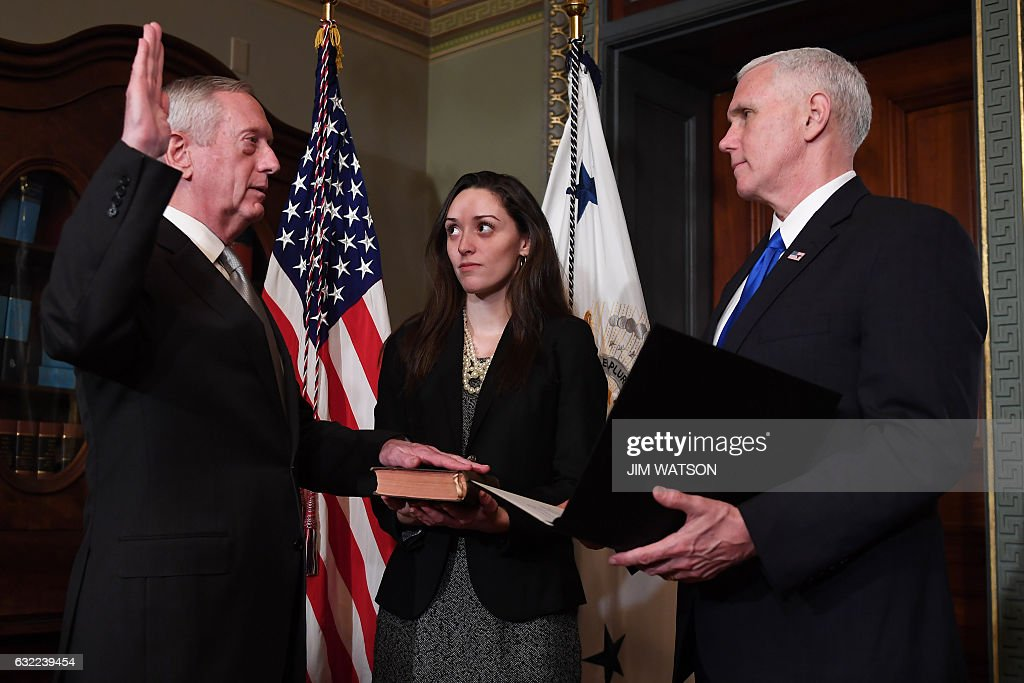 US Vice President Mike Pence (R) swears in James Mattis (L) as US Secretary of Defense in the Vice President's Ceremonial Office in the Old Executive Office Building in Washington, DC, January 20, 2017. / AFP / JIM