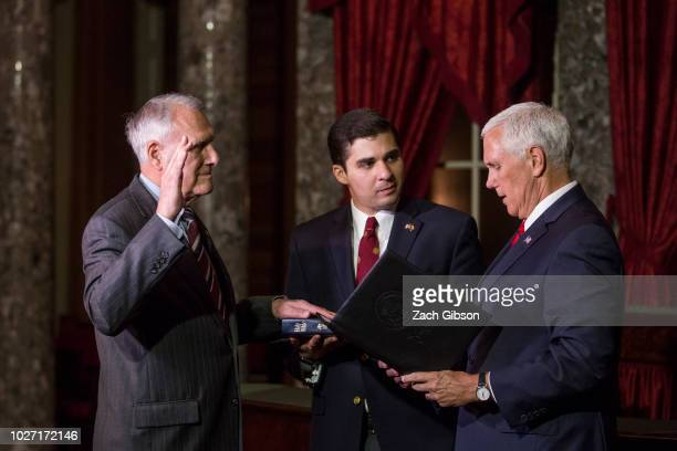S Vice President Mike Pence swears in Sen John Kyl as Kyl's grandson Christopher Gavin holds the bible during a mock swearin ceremony on September 5...