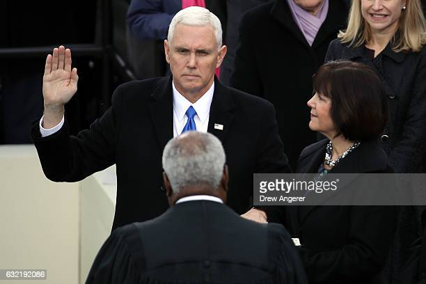 S Vice President Mike Pence takes the oath of office on the West Front of the US Capitol on January 20 2017 in Washington DC In today's inauguration...
