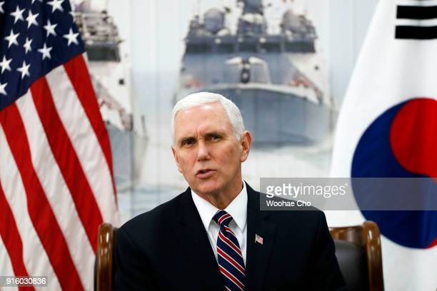 US Vice President Mike Pence talks at the meeting with Fred Warmbier the father of Otto warmbier who was imprisoned in North Korea for 17 months and...