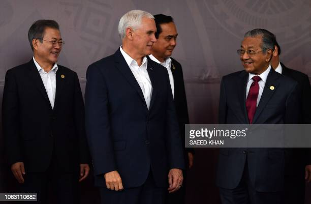 US Vice President Mike Pence talks to Malaysia's Prime Minister Mahathir Mohamad as South Korea's President Moon Jaein and Thailand's Prime Minister...