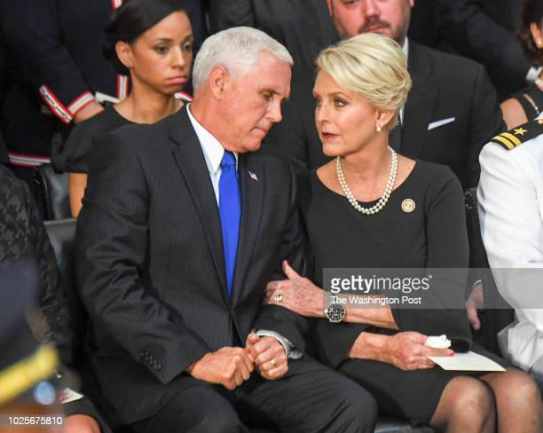 Vice President Mike Pence talks with Cindy McCain after he made remarks as the body of lateSen John S McCain lies in state during a ceremony to honor...