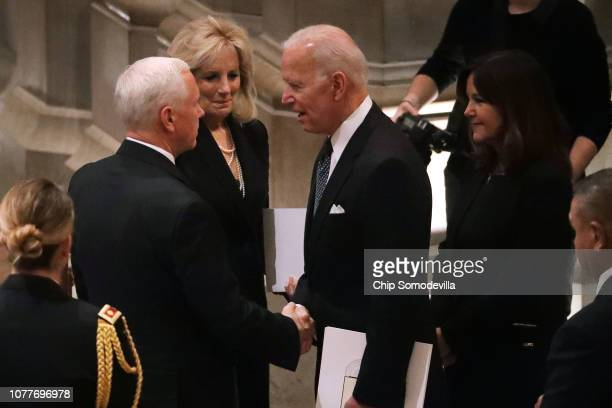 Vice President Mike Pence talks with former Vice President Joe Biden and Jill Biden during the state funeral for former President George HW Bush at...