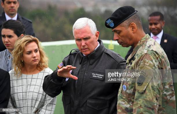 US Vice President Mike Pence talks with US General Vincent K Brooks commander of the United Nations Command Combined Forces Command and United States...