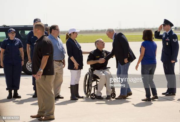 US Vice President Mike Pence third right shakes hands with Greg Abbott governor of Texas center after landing at Corpus Christi International Airport...