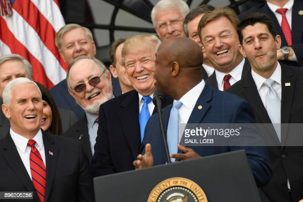 Vice President Mike Pence, US President Donald Trump and House speaker Paul Ryan listen as Republican Senator Tim Scott speaks about the passage of...