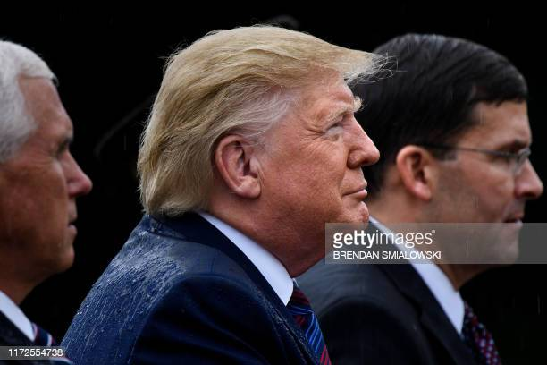 US Vice President Mike Pence US President Donald Trump and US Secretary of Defense Mark Esper listen during a welcome ceremony for Chairman of the...