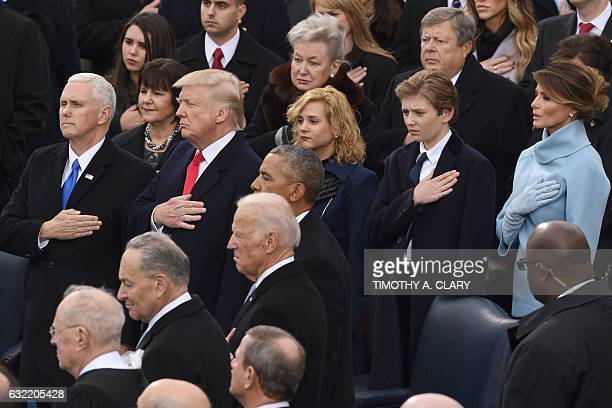 US Vice President Mike Pence US President Donald Trump his wife Melania and son Barron pray during the swearingin ceremony as 45th President of the...