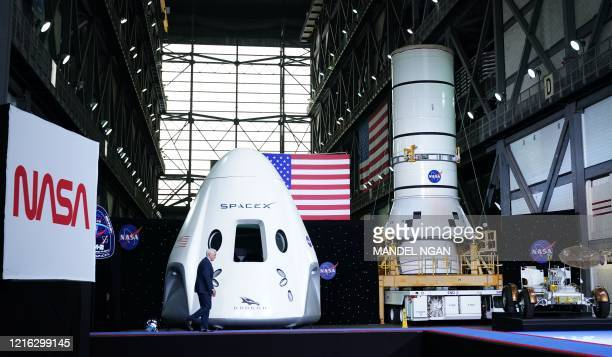 Vice President Mike Pence walks past a SpaceX Crew Dragon capsule at a press briefing after the launch of the SpaceX Falcon 9 rocket and Crew Dragon...