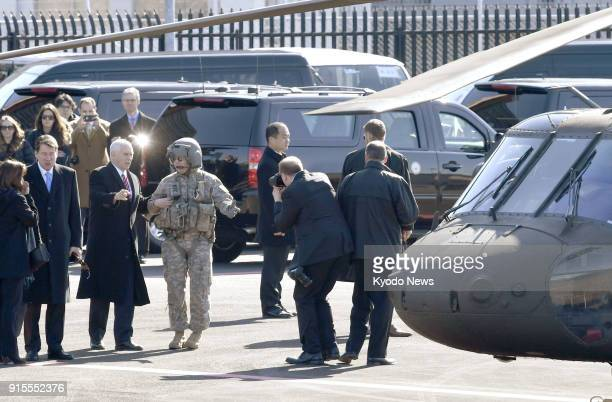 US Vice President Mike Pence walks toward a helicopter at Akasaka Press Center a facility of the US military in Tokyo's Roppongi district before...
