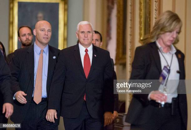 S Vice President Mike Pence walks towards the House chamber as they House votes for the tax bill on December 19 2017 in Washington DC The House...