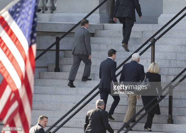 US Vice President Mike Pence walks with White House Senior Adviser Jared Kushner and Secretary of Homeland Security Kirstjen Nielsen as they arrive...