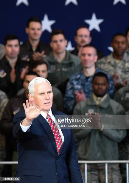 US Vice President Mike Pence waves after addressing US soldiers at Yokota Air Base at Fussa near Tokyo on February 8 2018 Pence is on the last day of...