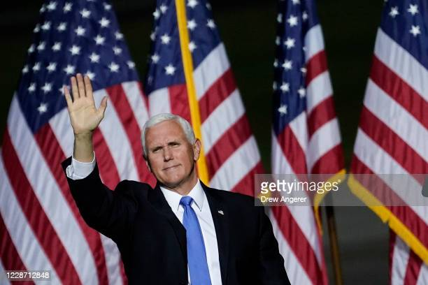 Vice President Mike Pence waves after speaking during a campaign rally at Newport News/Williamsburg International Airport on September 25, 2020 in...