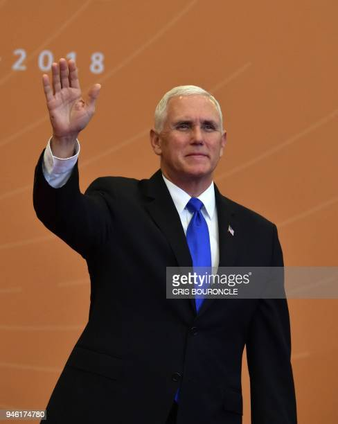 US Vice President Mike Pence waves as he arrives for the family photo of the Eighth Americas Summit in Lima on April 14 2018 US strikes on Syria...