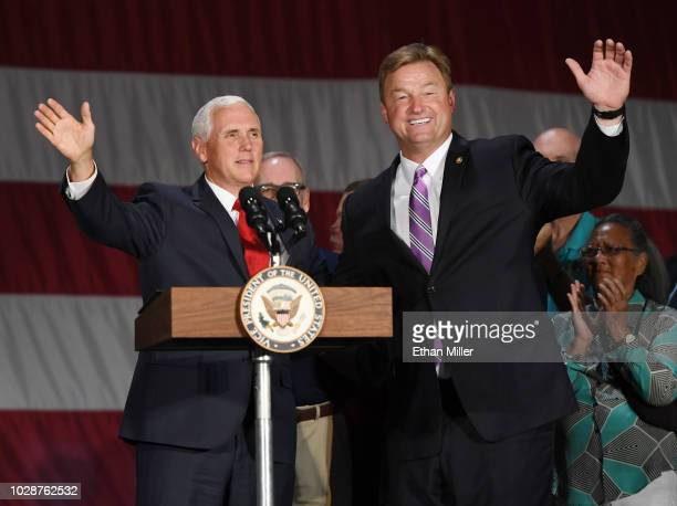 S Vice President Mike Pence waves as he is introduced by US Sen Dean Heller at Nellis Air Force Base on September 7 2018 in Las Vegas Nevada Pence is...