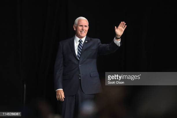 Vice President Mike Pence waves to guests at the NRAILA Leadership Forum at the 148th NRA Annual Meetings Exhibits on April 26 2019 in Indianapolis...