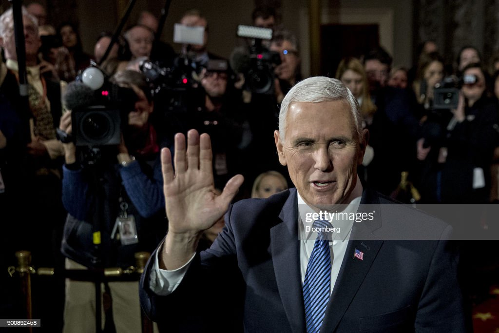 U.S. Vice President Mike Pence waves to photographers after swearing-in Senator Doug Jones, a Democrat from Alabama, not pictured, during a mock swear-in ceremony in the Old Senate Chamber of the U.S. Capitol in Washington, D.C, U.S., on Wednesday, Jan. 3, 2018. Jones won a special election over Roy Moore to fill out the rest of the unexpired term of Attorney General Jeff Sessions. Photographer: Andrew Harrer/Bloomberg via Getty Images