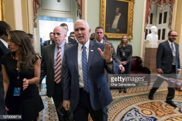 Vice President Mike Pence waves to reporters as he leaves the weekly Senate Republican policy luncheon at the US Capitol November 27 2018 in...