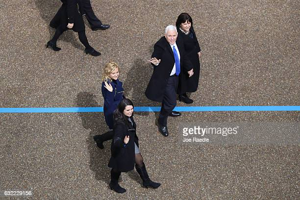 S Vice President Mike Pence waves to supporters as he walks the parade route with his wife Karen Pence and their daughters Audrey Pence and Charlotte...