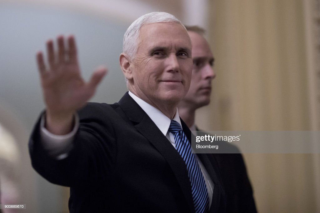 U.S. Vice President Mike Pence waves while arriving to a swearing in ceremony in the Old Senate Chamber of the U.S. Capitol in Washington, D.C, U.S., on Wednesday, Jan. 3, 2018. Two new Democrats arrived in the U.S. Senate Wednesday, reducing the Republican majority to one vote and lifting the number of women in the chamber to a record level. Photographer: Aaron P. Bernstein/Bloomberg via Getty Images