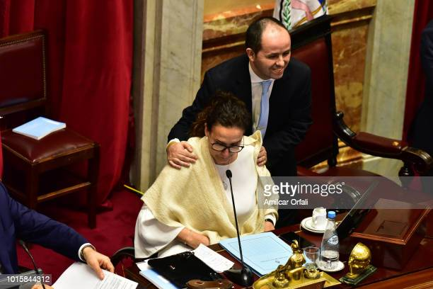 Vice president of Argentina Gabriela Michetti looks at a notebook as senators vote for the new abortion law on August 9 2018 in Buenos Aires...