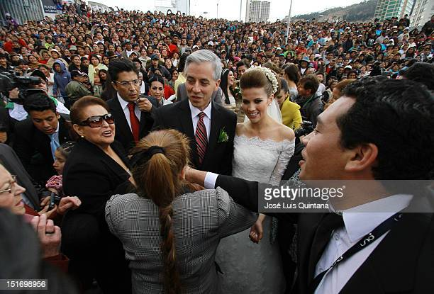 Vice President of Bolivia Alvaro Garcia Linera and the journalist Claudia Fernandez greet the public after religious marriage in the church of San...
