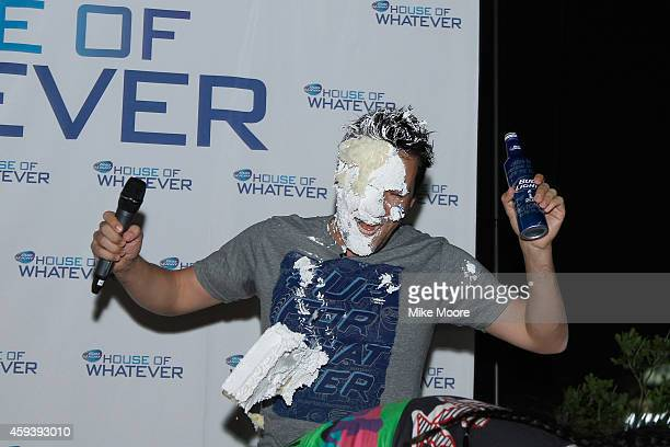 Vice President of Budl Light Alex Lambrechthas cake smashed into his face by Grammy Awardnominated DJ Steve Aoki during the Bud Light House Of...