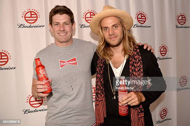 Vice President of Budsweiser Brian Perkins and Nick Van Hofwegen of Young and Sick pose backstage at the 2014 Budweiser Made In America Festival at...