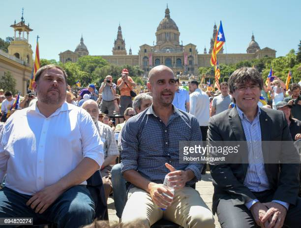 Vice President of Catalunya Oriol Junqueras Pep Guardiola and President of Catalunya Carles Puigdemont attend a rally in support of a referendum for...