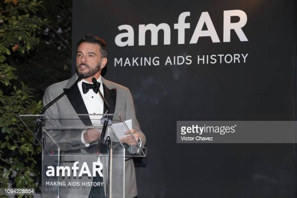 Vice President of Development of amFAR Eric Muscatell speaks during the amfAR gala dinner at the house of collector and museum patron Eugenio López...