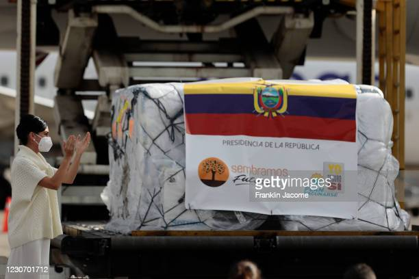 Vice President of Ecuador, María Alejandra Muñoz applauds after receiving the shipment of 8,000 doses of the Pfizer-BioNtech Covid-19 vaccine on...